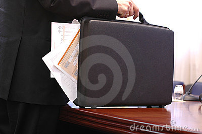 Carrying  overloaded briefcase