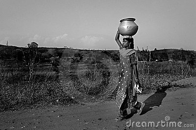 Carrying water Editorial Stock Image