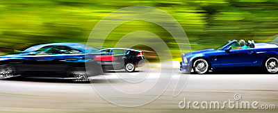 Cars in blurred motion on road. Abstract background.