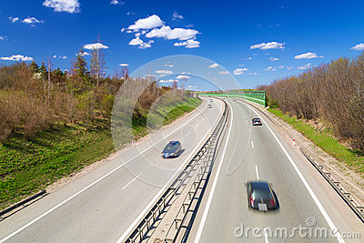 Cars on the highway near Gdansk in sunny day
