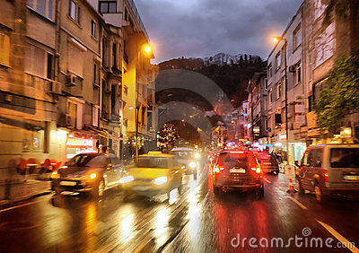 cars and night traffic lights in rainy city