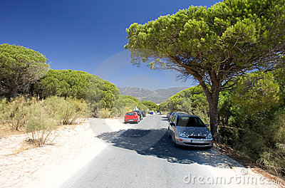 Cars parked on sandy road in Tarifa southern Spain