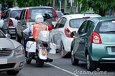 Cars & policeman in traffic jam