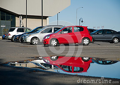 Cars reflected in carpark