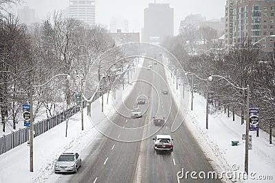 Cars on slushy road Editorial Photo