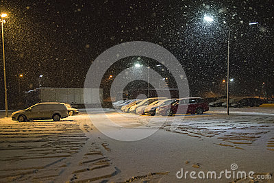 Cars snowing down in the parking lot