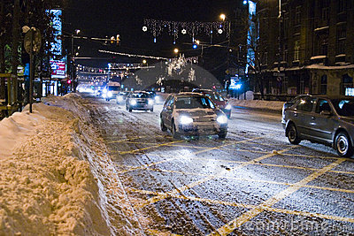 Cars on snowy road in Bucharest Editorial Stock Image
