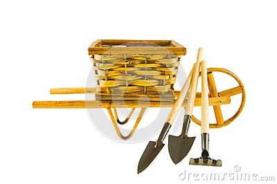 The cart  with garden tools isolated over white