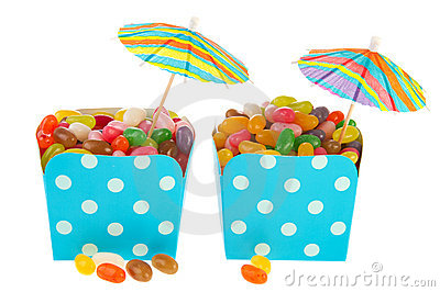 Cartons colorful candy with parasols