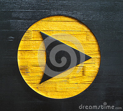 Carved arrow sign on wood