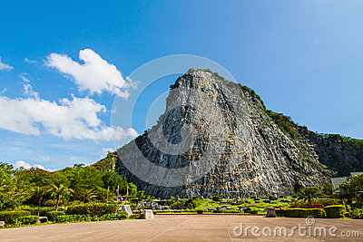 Carved buddha image on the cliff