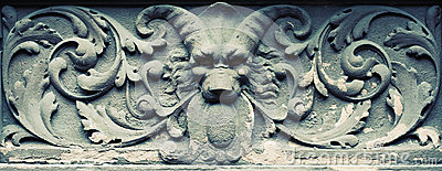 Carved devil in stone