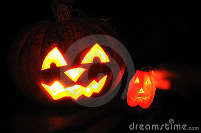 The carved face of pumpkin glowing