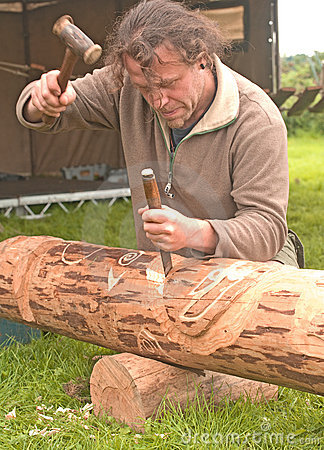 Carving a totem pole. Editorial Photography