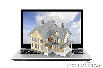 Casa amarilla en el ordenador portátil