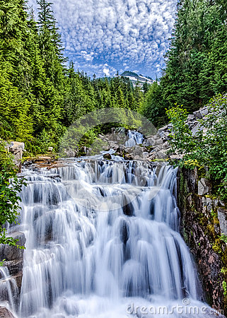Cascading stream in Mt. Ranier National Park with sky