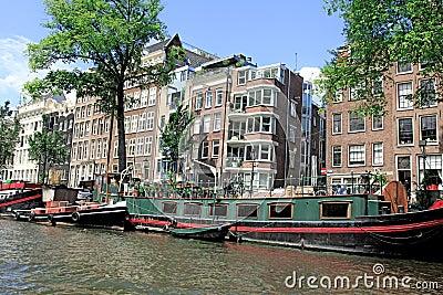 Case galleggianti del canale di amsterdam olanda for Case galleggianti amsterdam