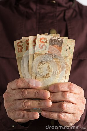 Free Cash Bills From Brazilian Currency. Old Retired Person Paying In Cash Royalty Free Stock Image - 131450706