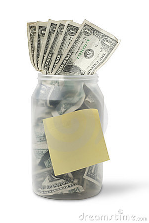 Cash jar with dollar bills and sticky note