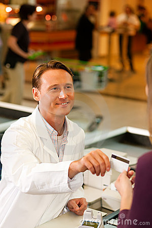 Cashier in supermarket taking credit card