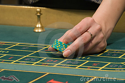 Casino dealer handling gambling chips
