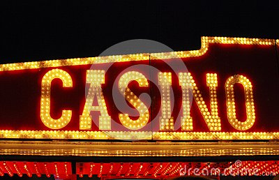 Casino sign over fairground arcade.