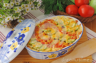 Casserole of pasta with zucchini and tomato