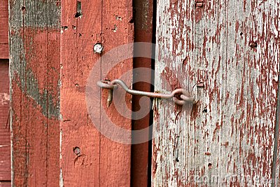 Cast Iron Hook And Eye Lock On Old Barn Door Stock Photo