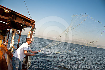 Casting nets on the Sea of Galilee Editorial Stock Photo