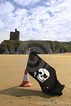 Castle and beach with jolly roger flag