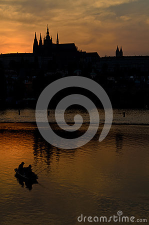 Castle district in prague and fishing boat