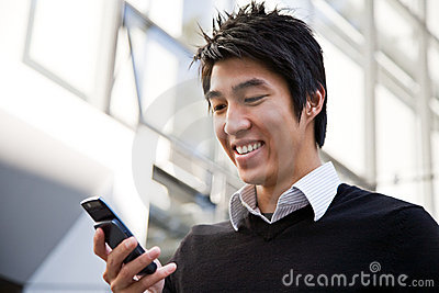Casual asian businessman texting