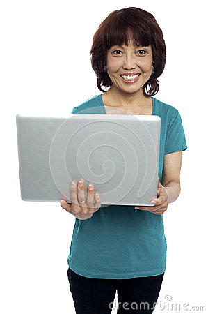Casual asian girl holding laptop