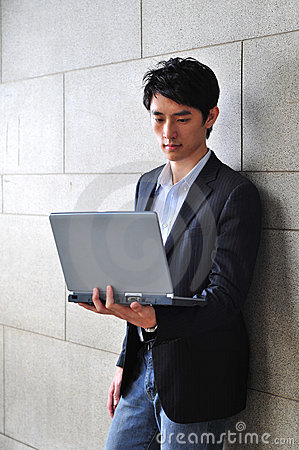 Casual Asian Man with laptop