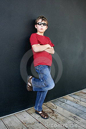 Casual boy leaning against wall