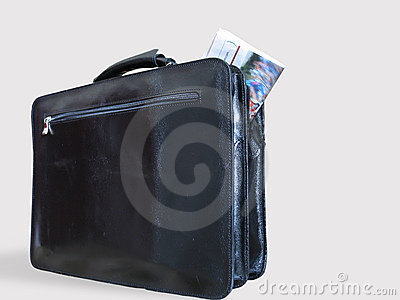 A Casual Briefcase and a Newspaper Inside It