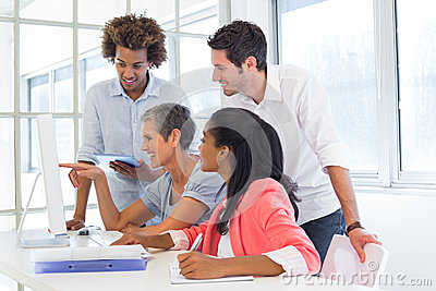 Casual Business Team Having A Meeting With Computer Stock Photo