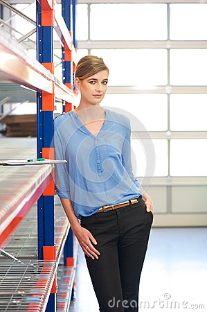 Casual business woman standing in warehouse