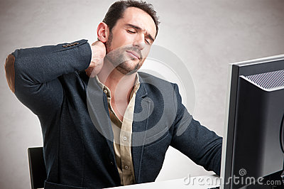 Casual Businessman With Pain In His Nec Stock Photo