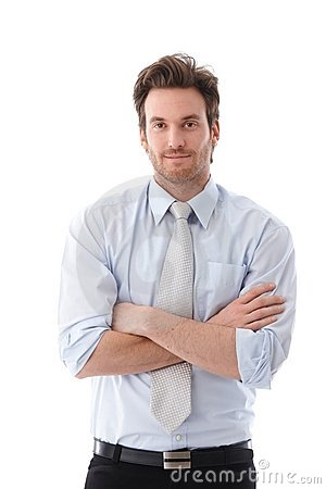 Casual businessman standing arms crossed smiling