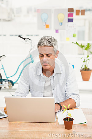 Casual businessman working with laptop Stock Photo