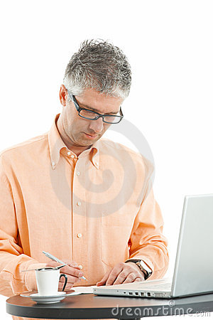 Casual businessman writing