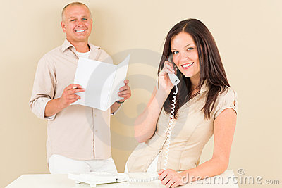 Casual businesswoman calling phone man colleague