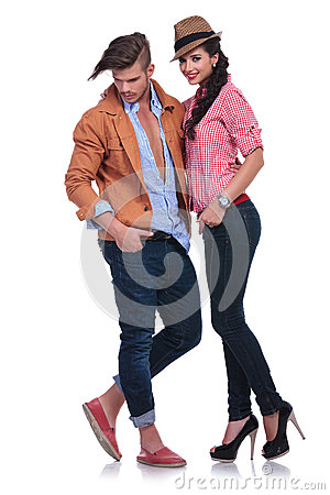 Casual couple with man looking down