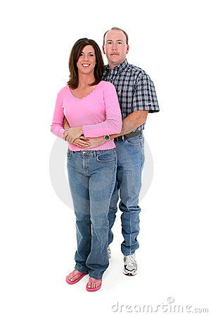 Casual Couple Standing Together Over White