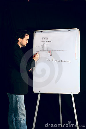 Casual Executive Gives Presentation on Whiteboard