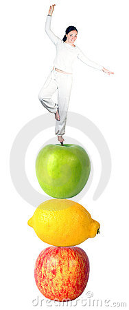 Casual girl balancing on fruits - balanced diet