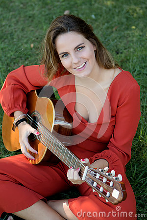 Free Casual Girl Dressed In Red Playing Guitar Royalty Free Stock Photo - 78114465