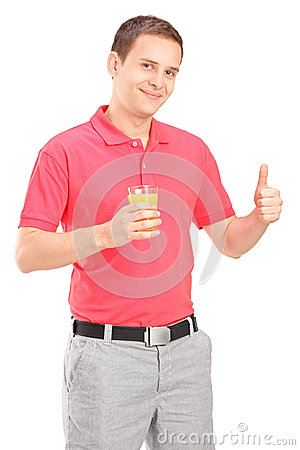 Casual guy holding a juice and giving thumb up