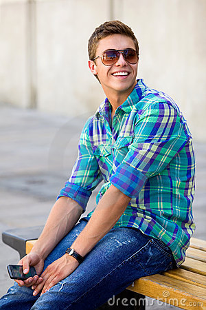 Casual guy sitting on bench